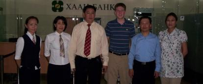 Business Interns pose for a photo with staff at a local bank in Mongolia.